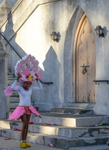 Nassau, Bahamas:  Boxing Day Junkanoo dancer putting on costume 12/26/13