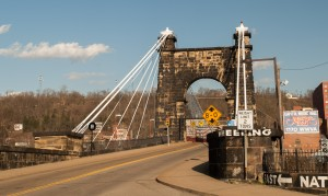 Wheeling, W.Va.:  Suspension Bridge (1849) across  Ohio River's main channel.  The slave market was one block from WWVA  sign.  3/13/12