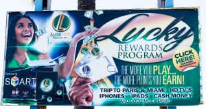 Nassau, BS:  Potters Cay, Islands Luck billboard  4/6/15